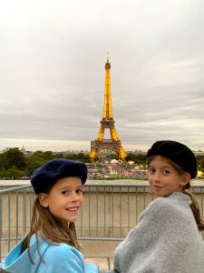 Young girls in berets with Eiffel Tower