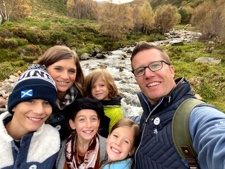 Family in Scotland by waterfall
