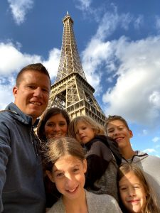 Family in front of Eiffel Tower