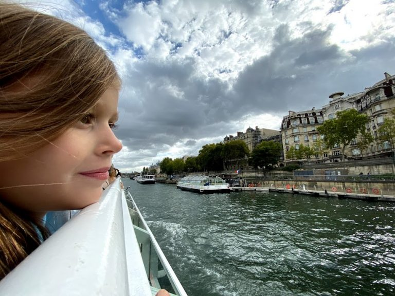 Girl overlooking Seine River on cruise