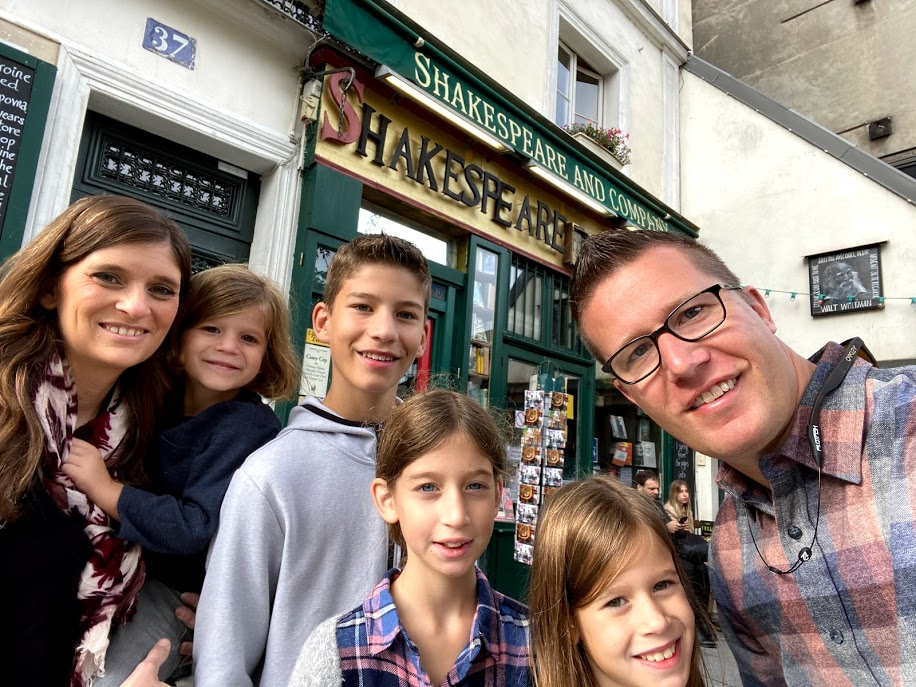 Family in front of Shakespeare and Company bookstore