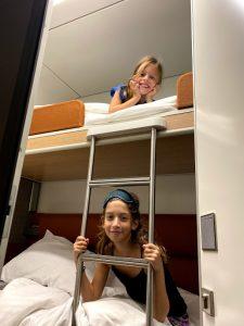 Kids on sleeper train bunk beds
