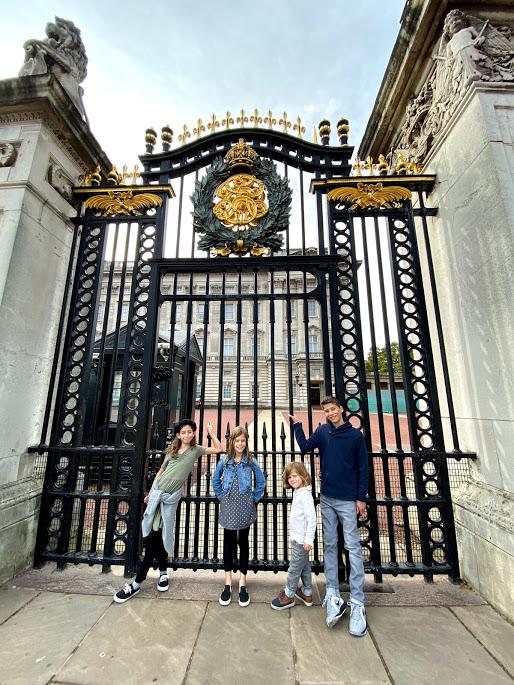 Kids standing at Buckingham Palace Gate