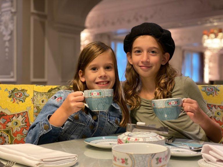Kid sisters having afternoon tea