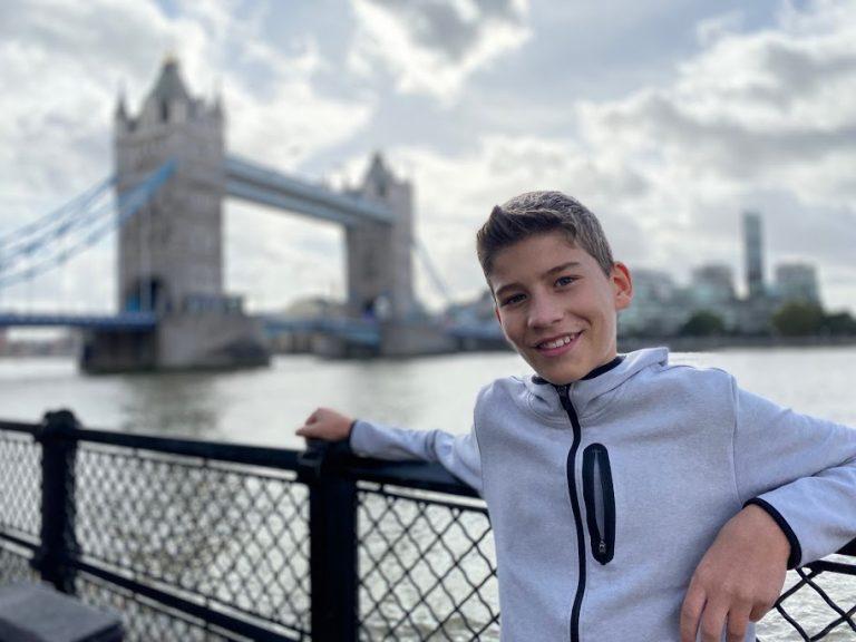 Teen boy in front of London Bridge