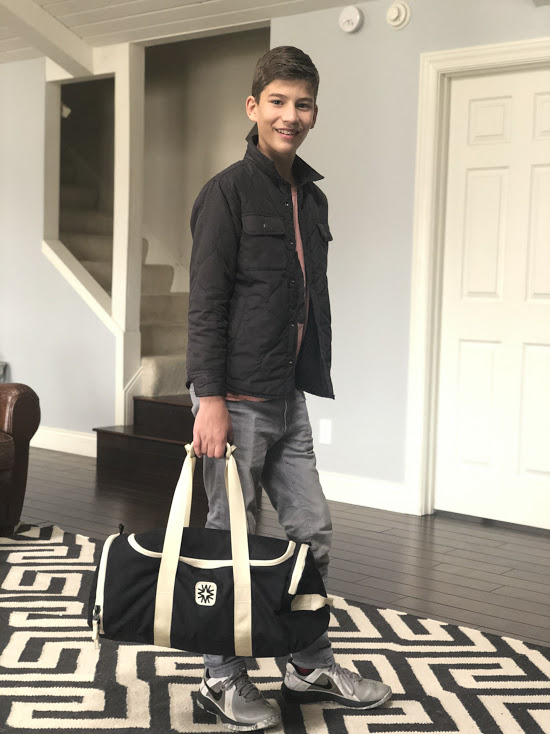 Teen Boy with Duffel Bag