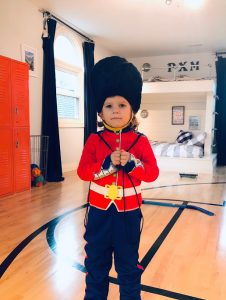 Toddler in British Guard Costume in boy's basketball bedroom