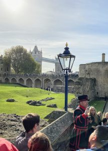 Beefeater giving tour with London Bridge in Background