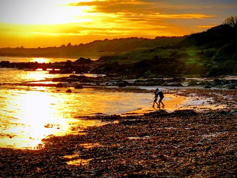 Kids on Scotland Coastline beach