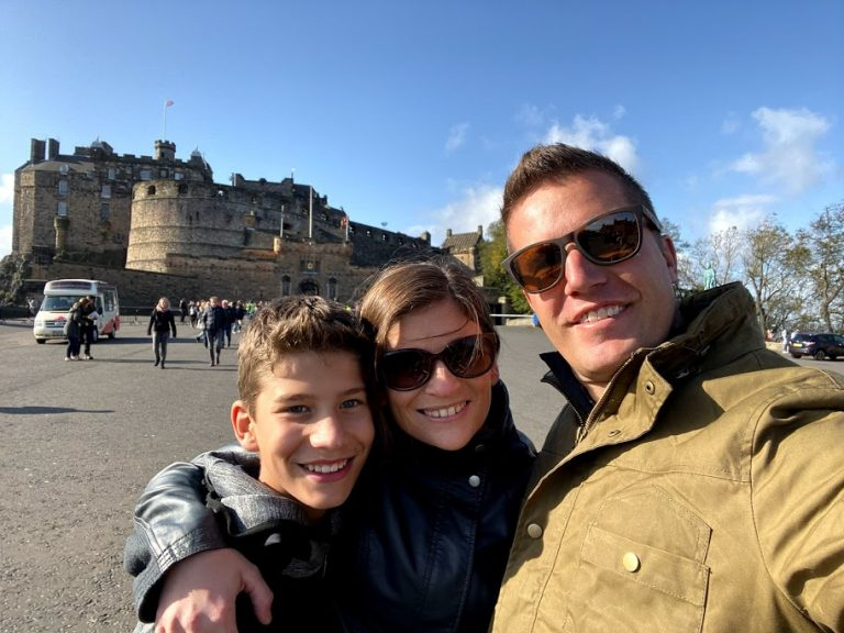 Parents with teen boy in front of Edinburgh Castle