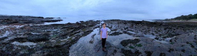 Panoramic picture of girl on Lower Largo beach