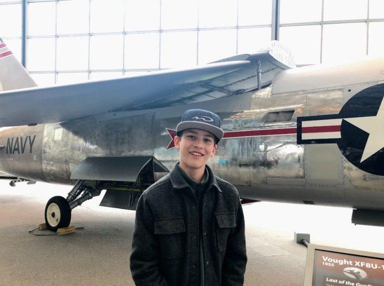 Posing with plane in Museum of Flight